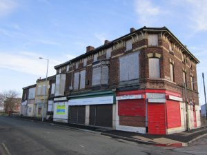Row of abandoned high street shops