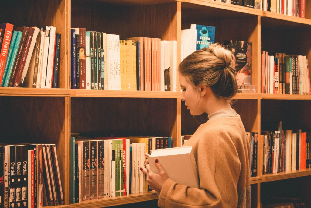 book girl at library - Abebooks